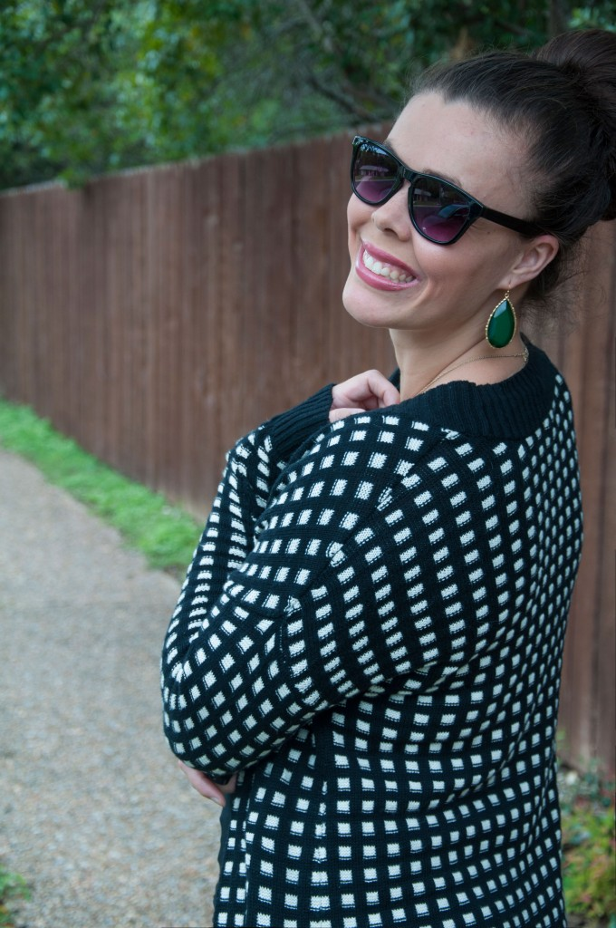 All That Glitters: Black and white sweater with emerald earrings