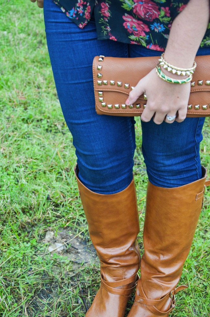 Floral top with cognac boots and clutch