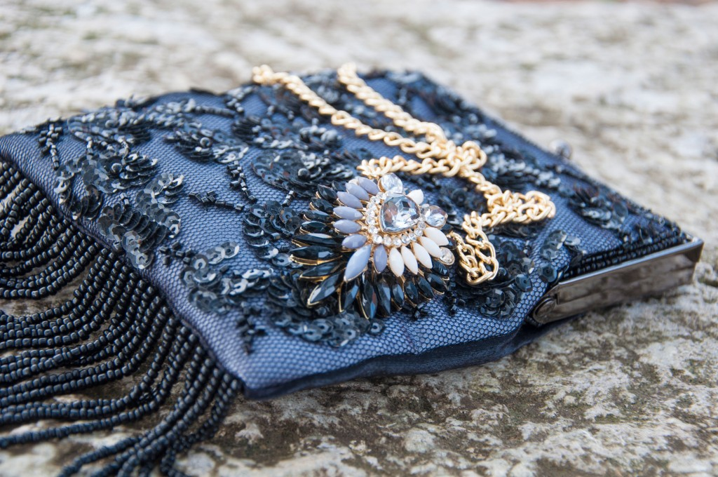 Beaded bag and gold necklace