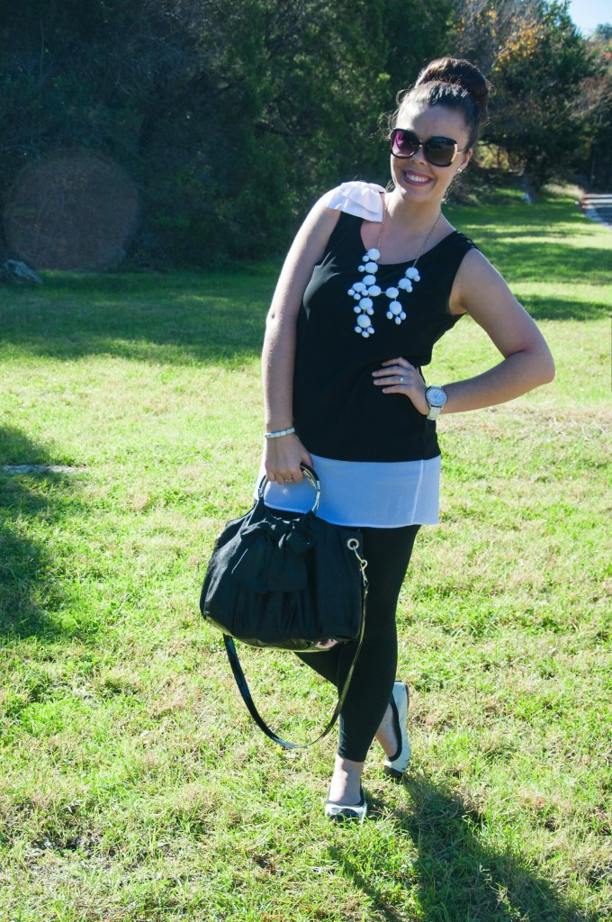 All That Glitters: Black leggings with a black and white bow top