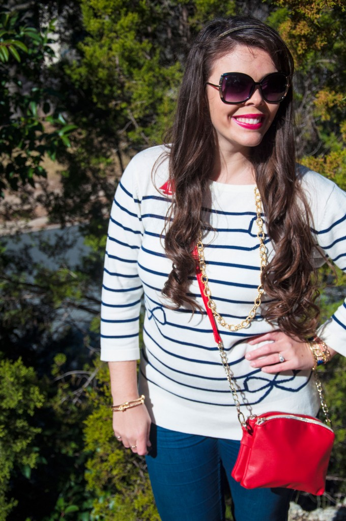 Blue striped sweater with red bag