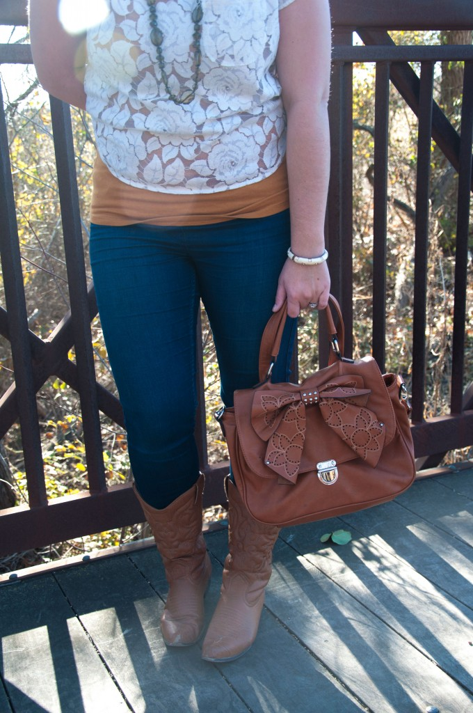 Cowboy boots and bow bag