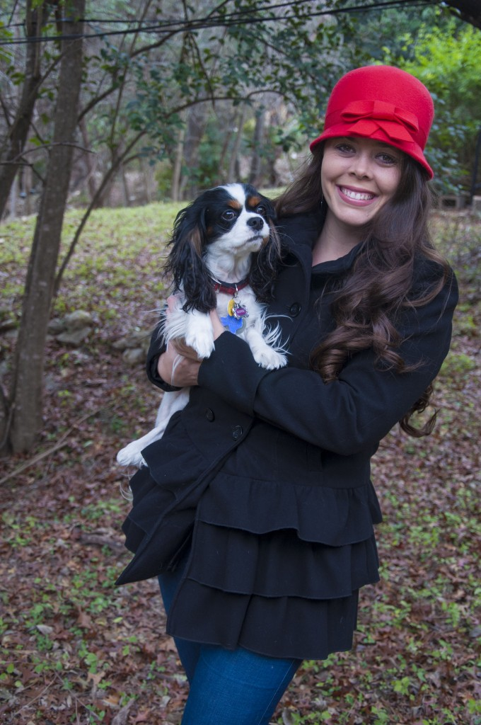 King charles and her owner with a red hat