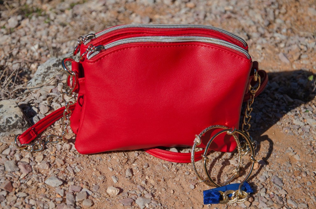 Red crossbody with blue accessories