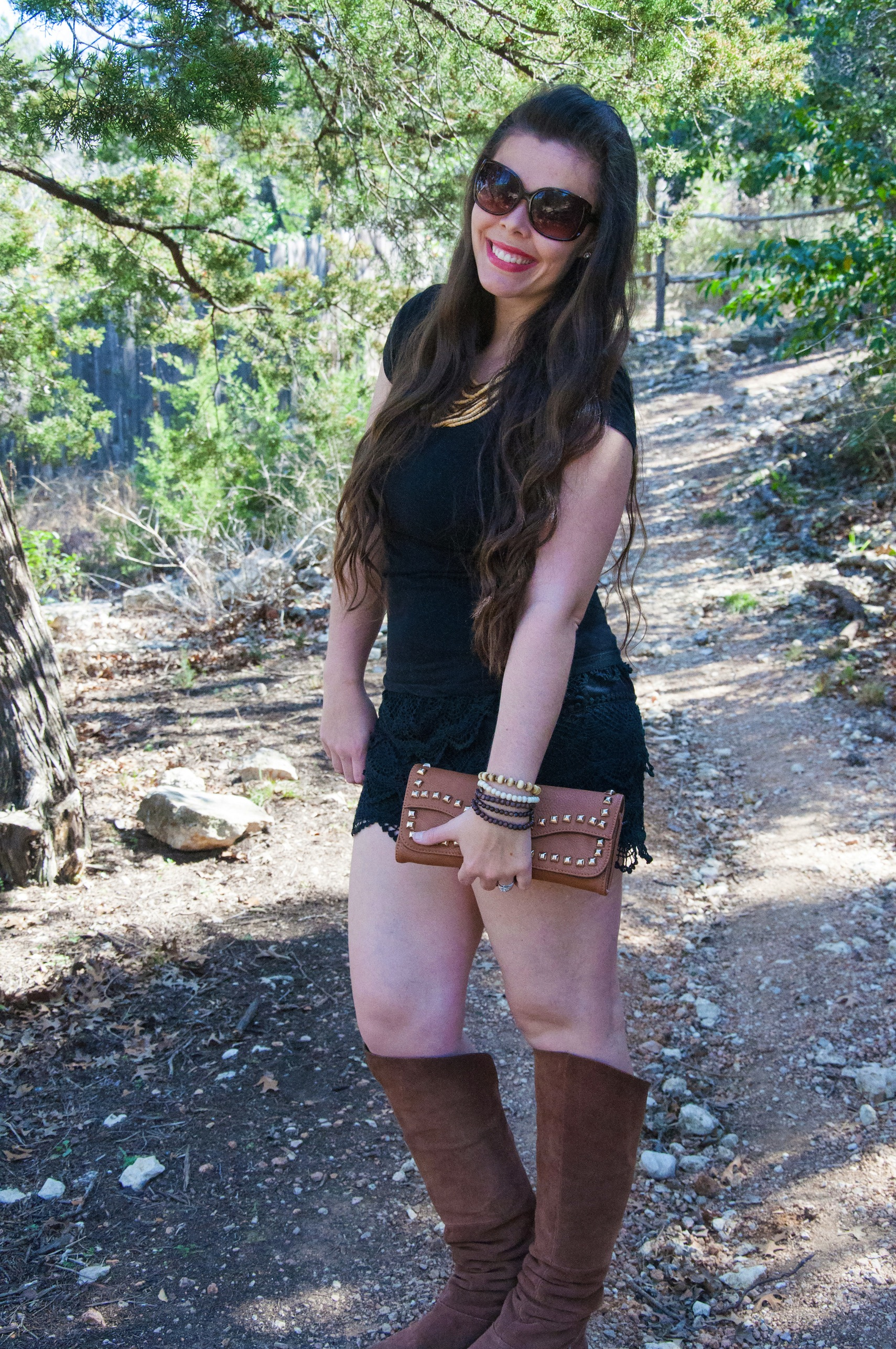 black lace shorts and knee high boots all that glitters