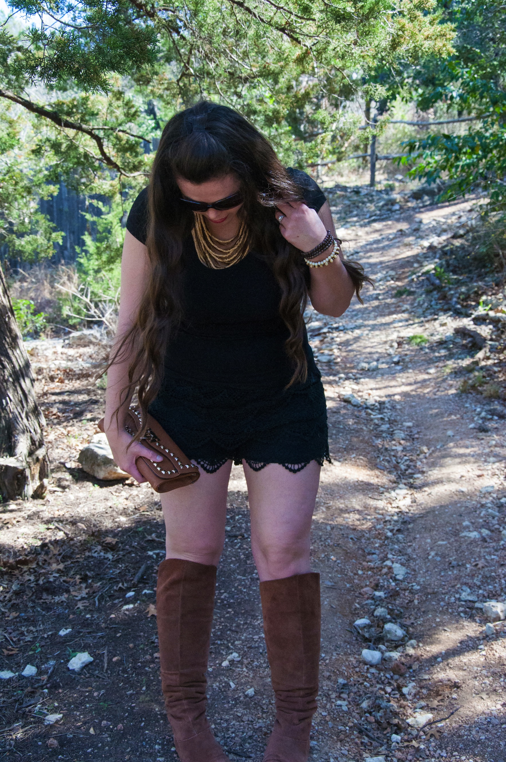 Black shorts with cognac boots