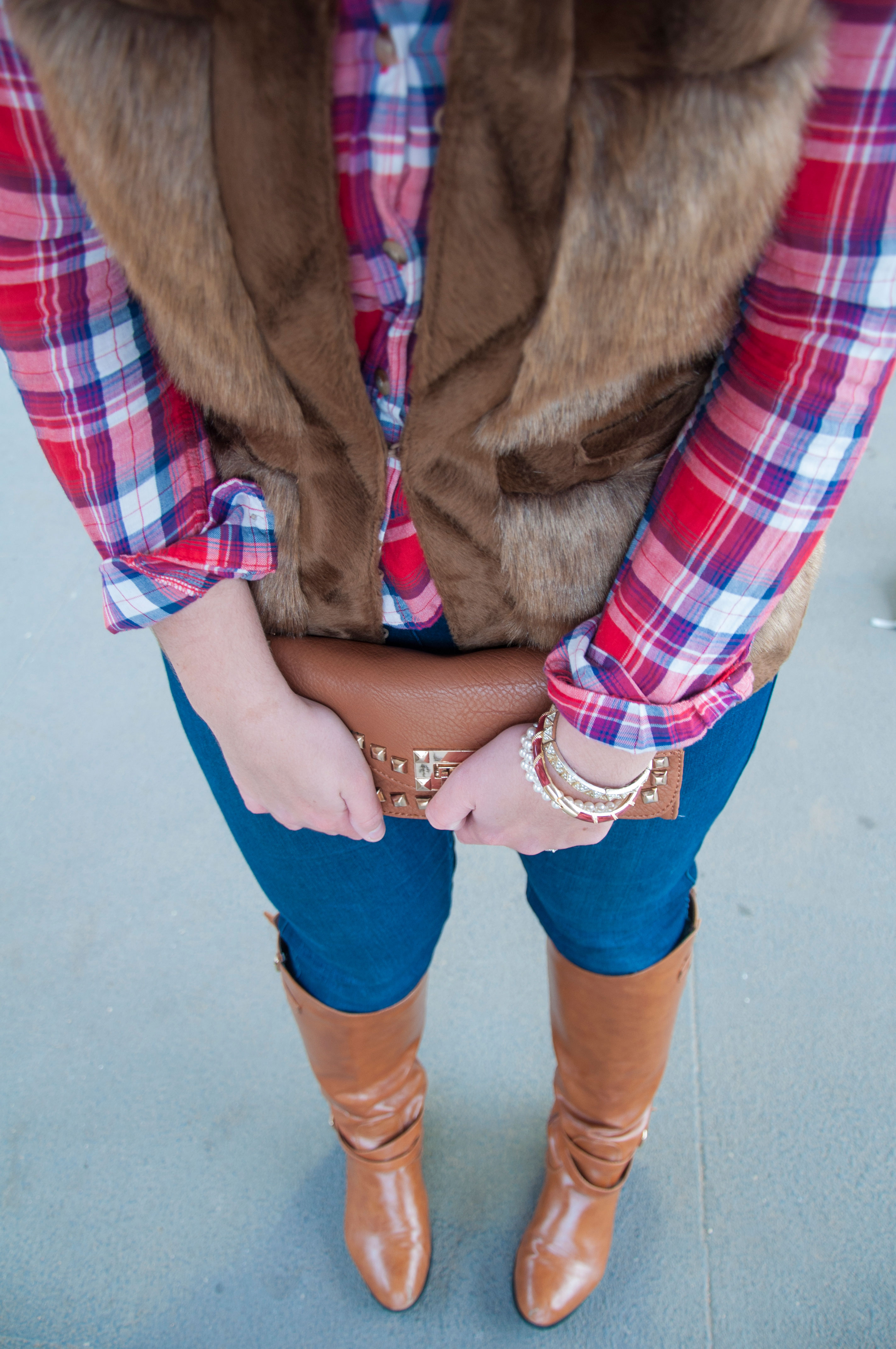 Fur vest, plaid shirt, and boots