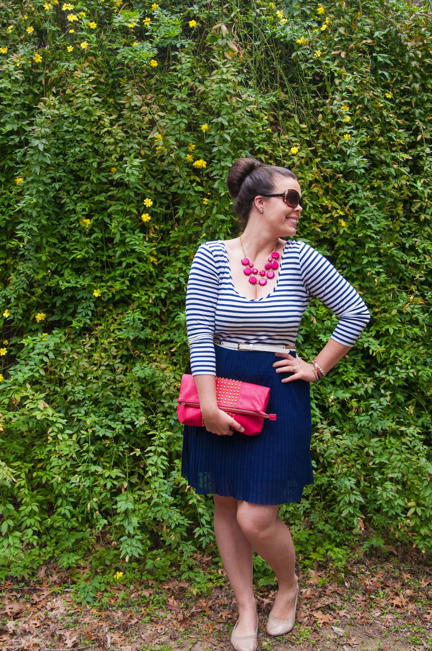 Navy blue striped dress with pink accessories