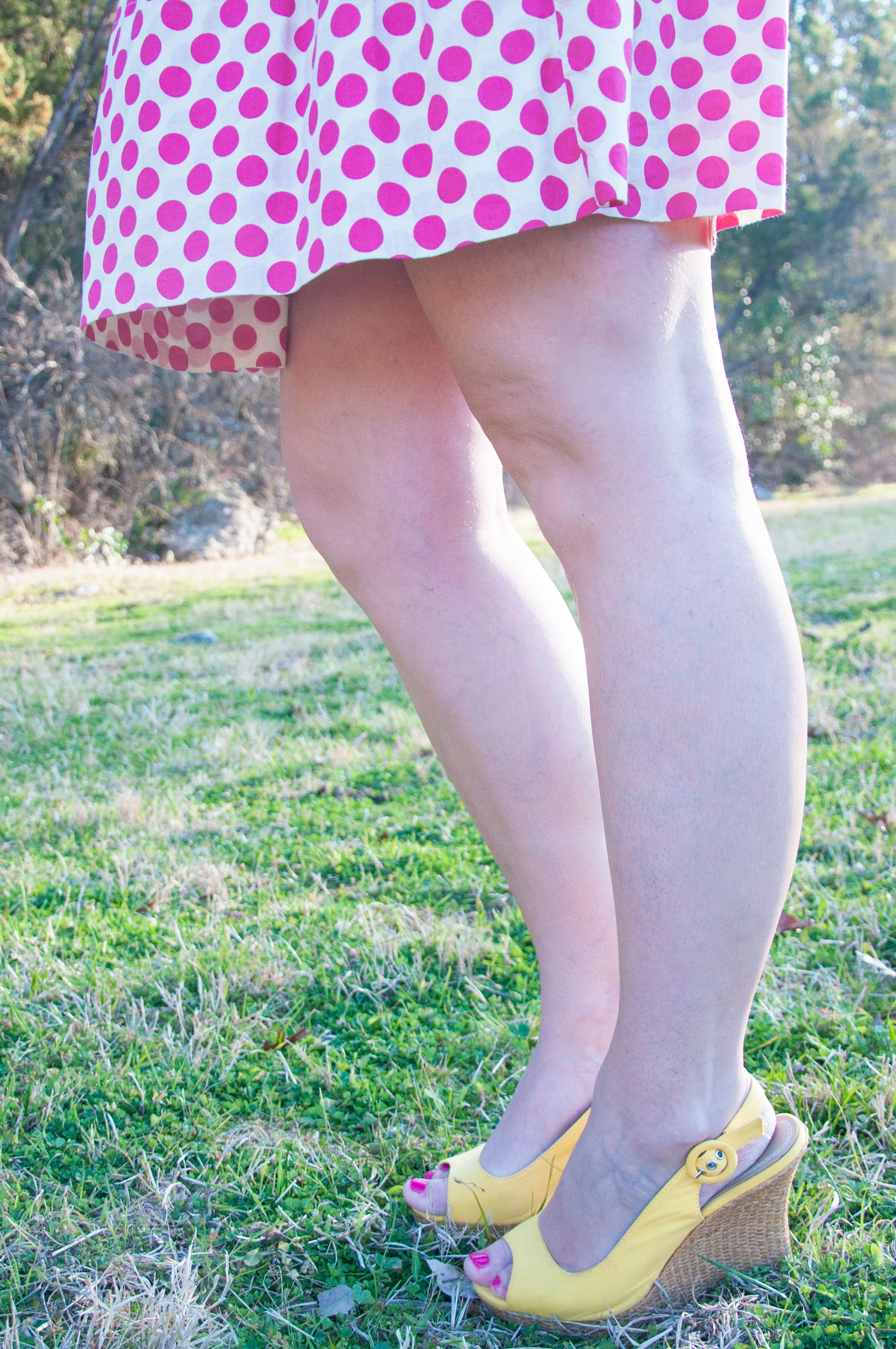 Pink polka dot dress with yellow wedges