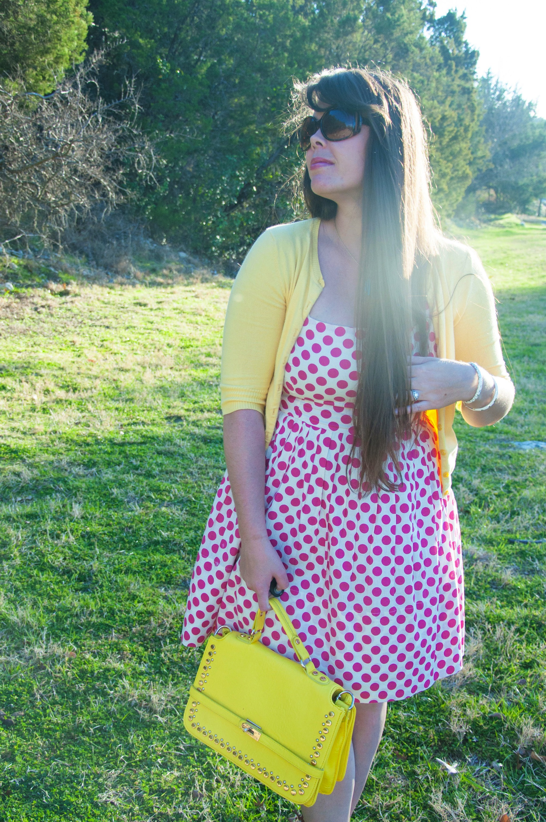 Yellow handbag with pink dress