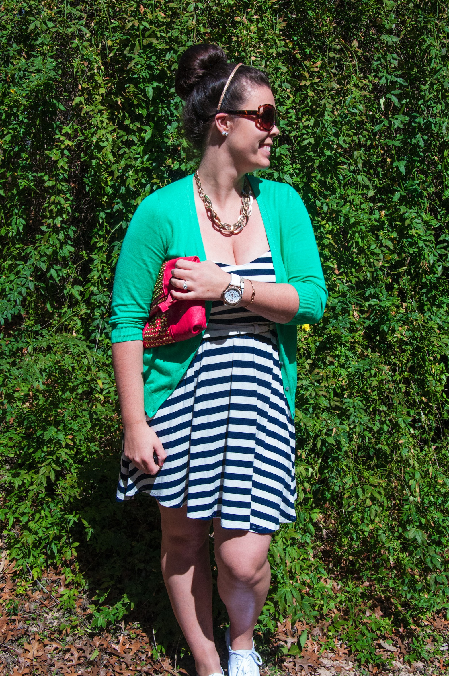 Green cardigan with a navy striped dress