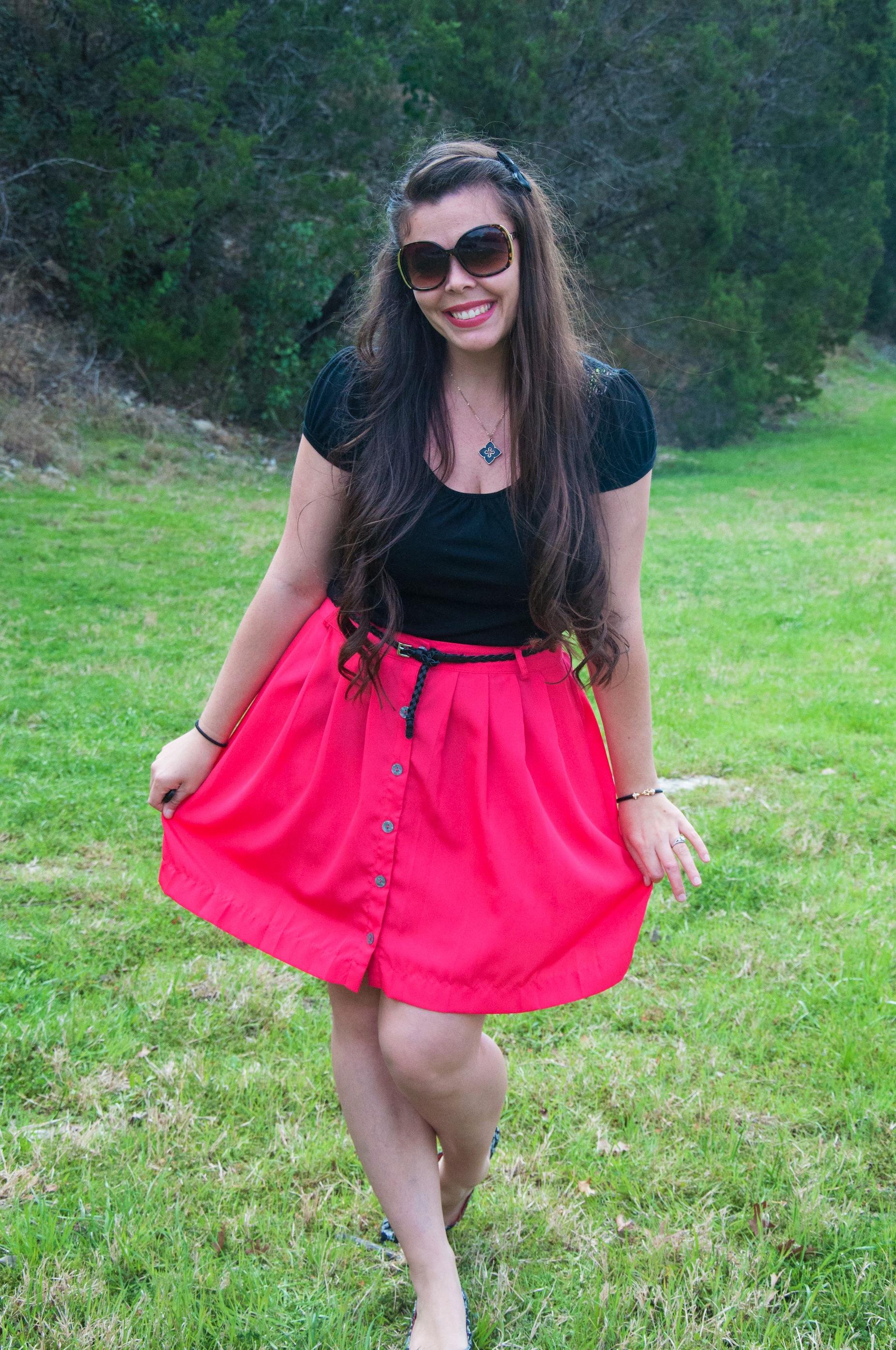 Pink midi skirt and black top