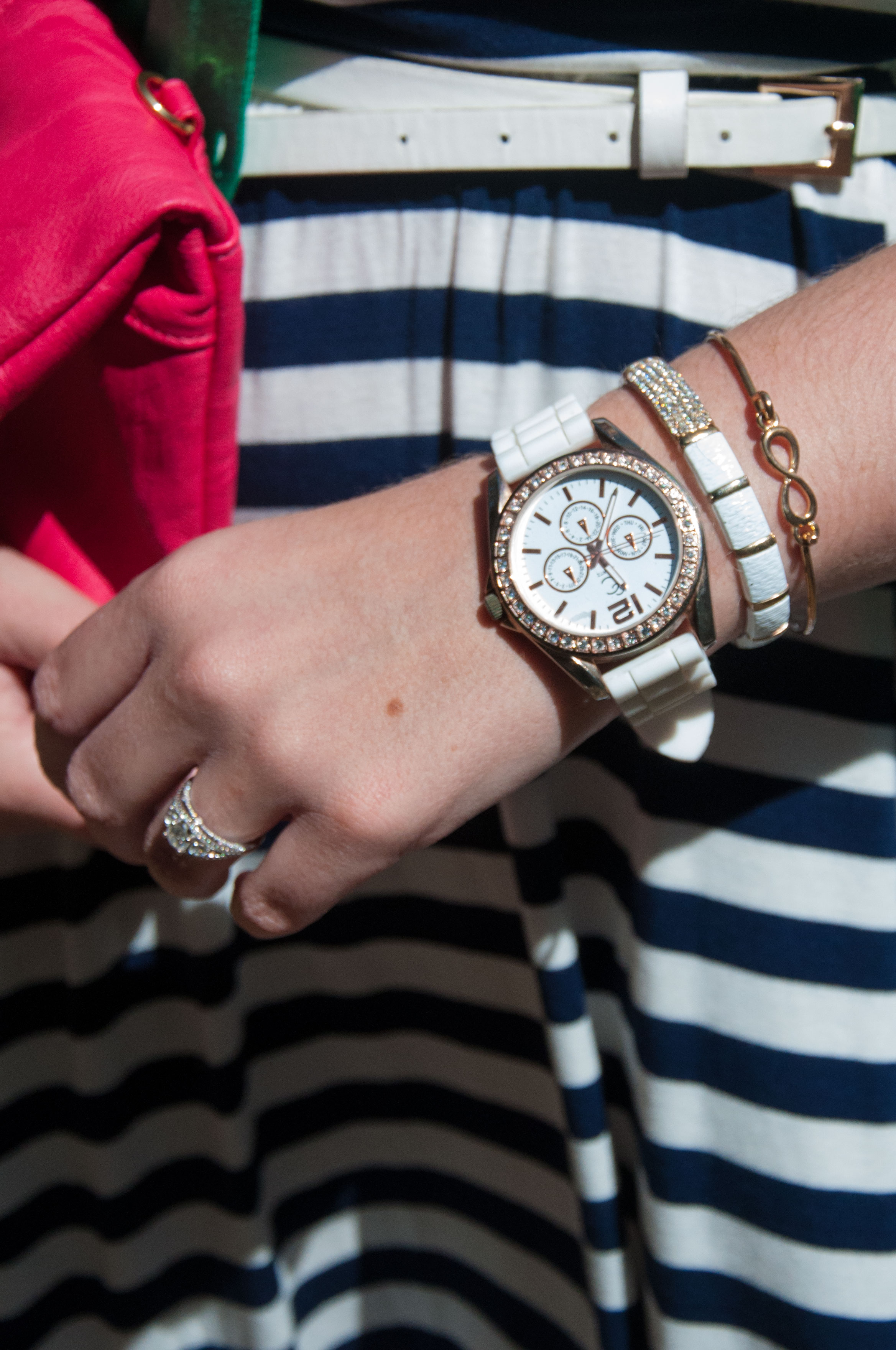 White and gold jewelery with a  Navy and White Striped dress