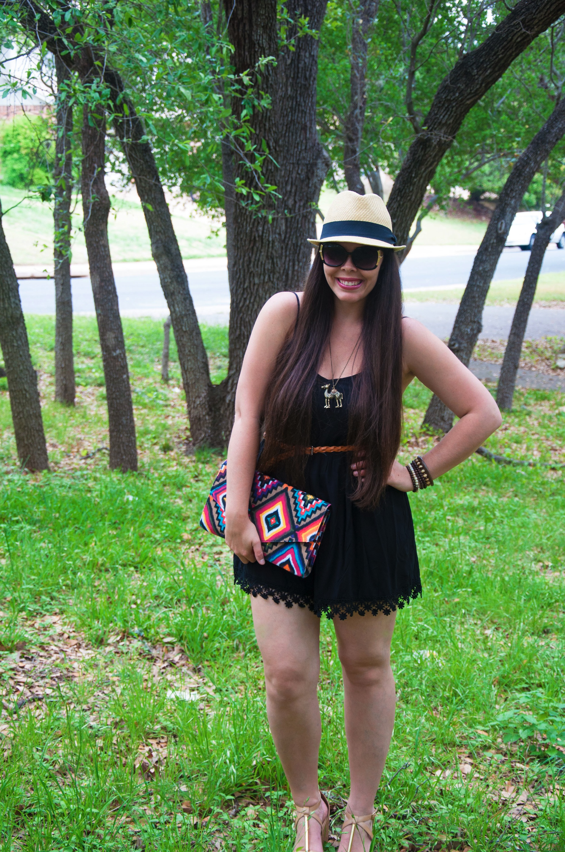 Black romper with aztec clutch