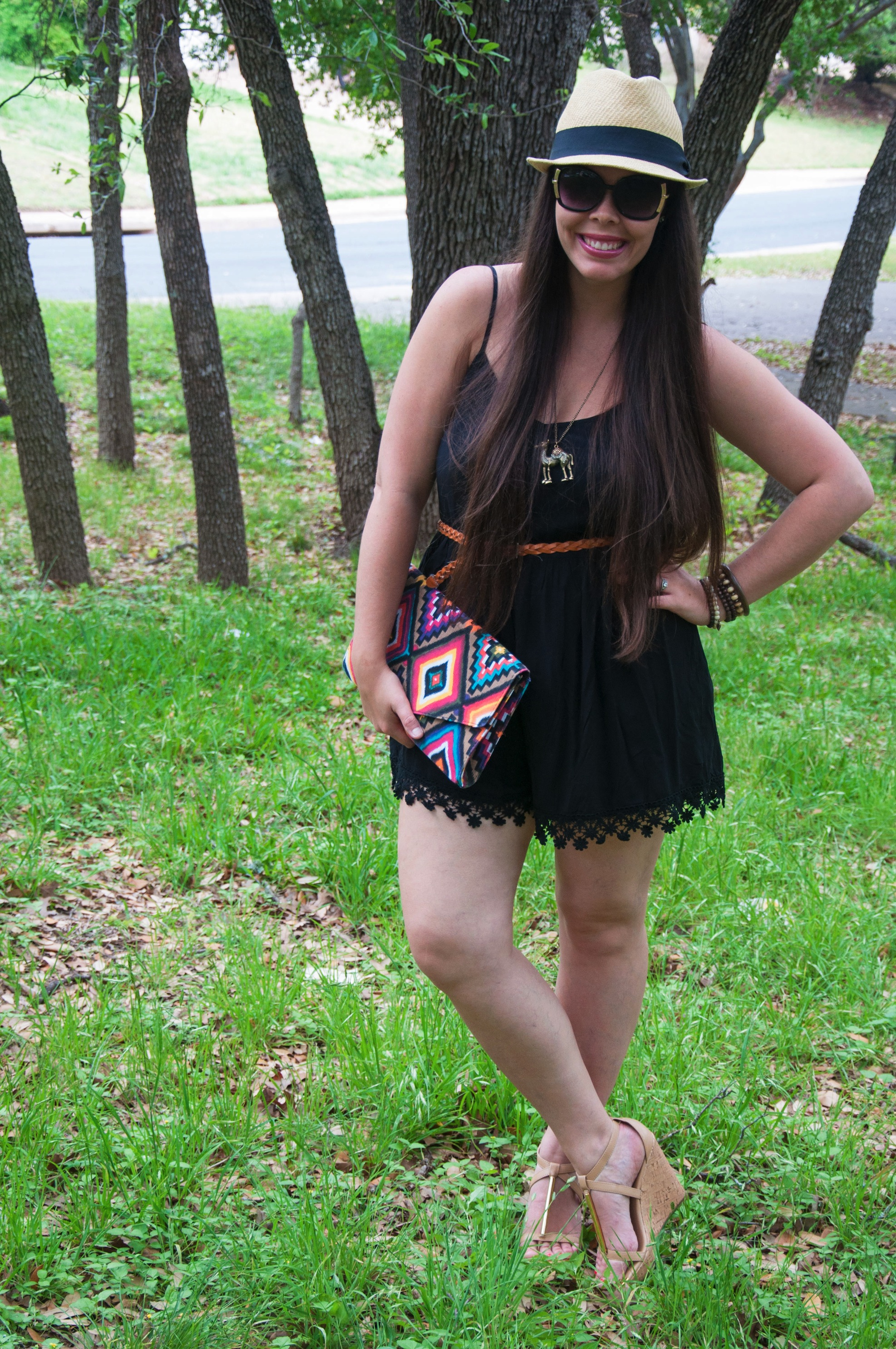 Black romper with fedora and wedges