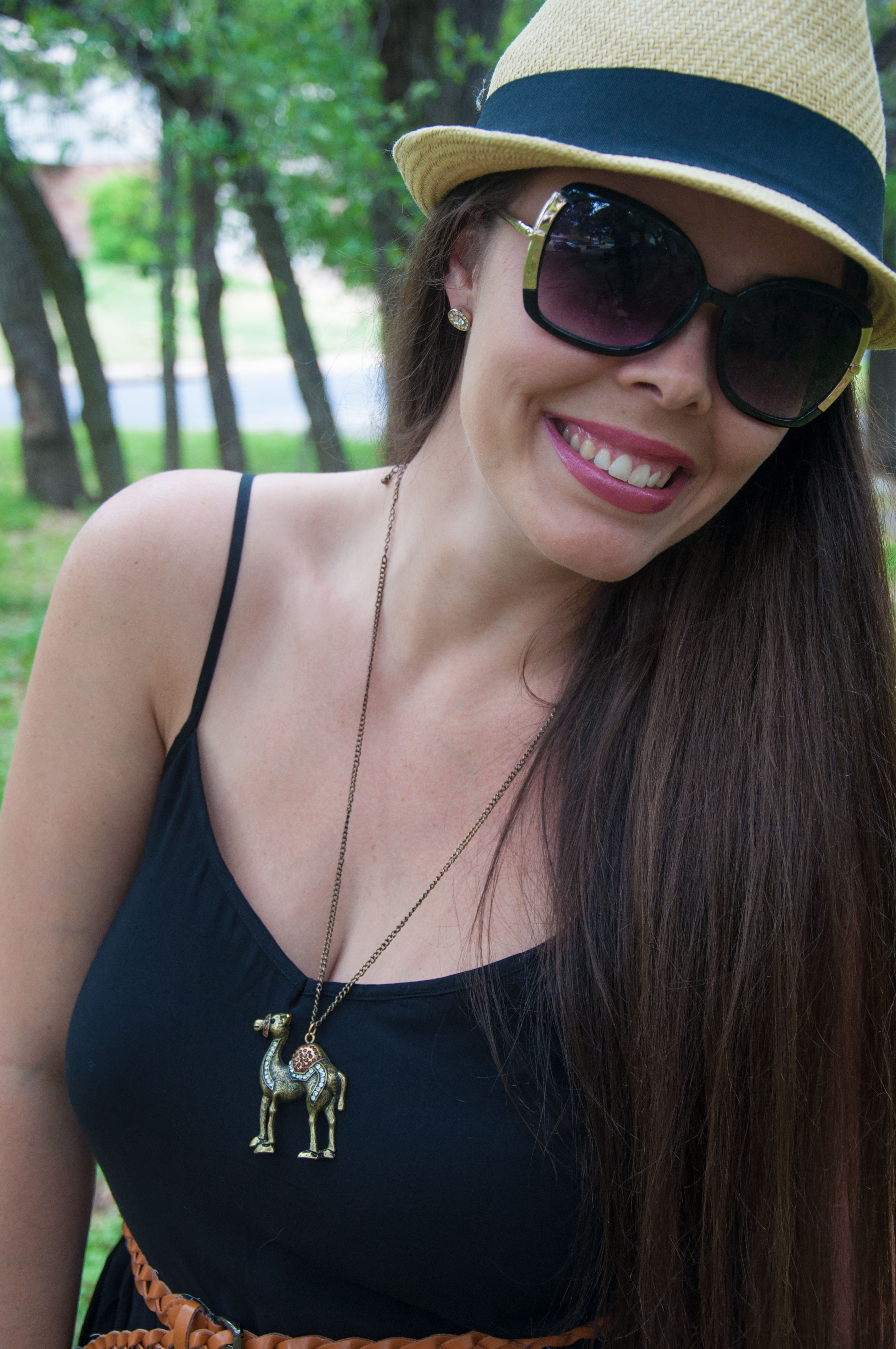 Camel necklace with a black romper and hat