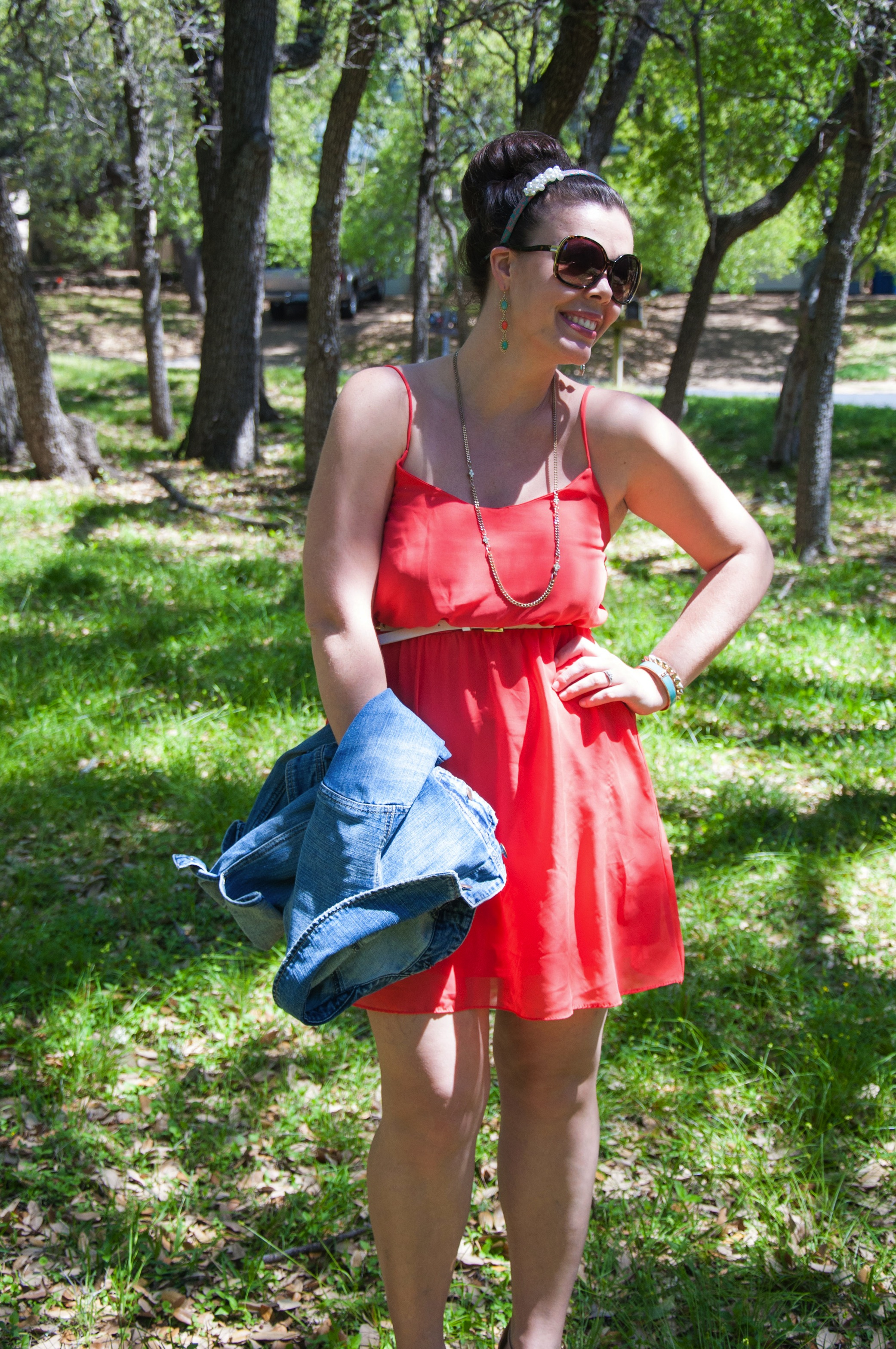 Coral sundress with denim jackets and wedges