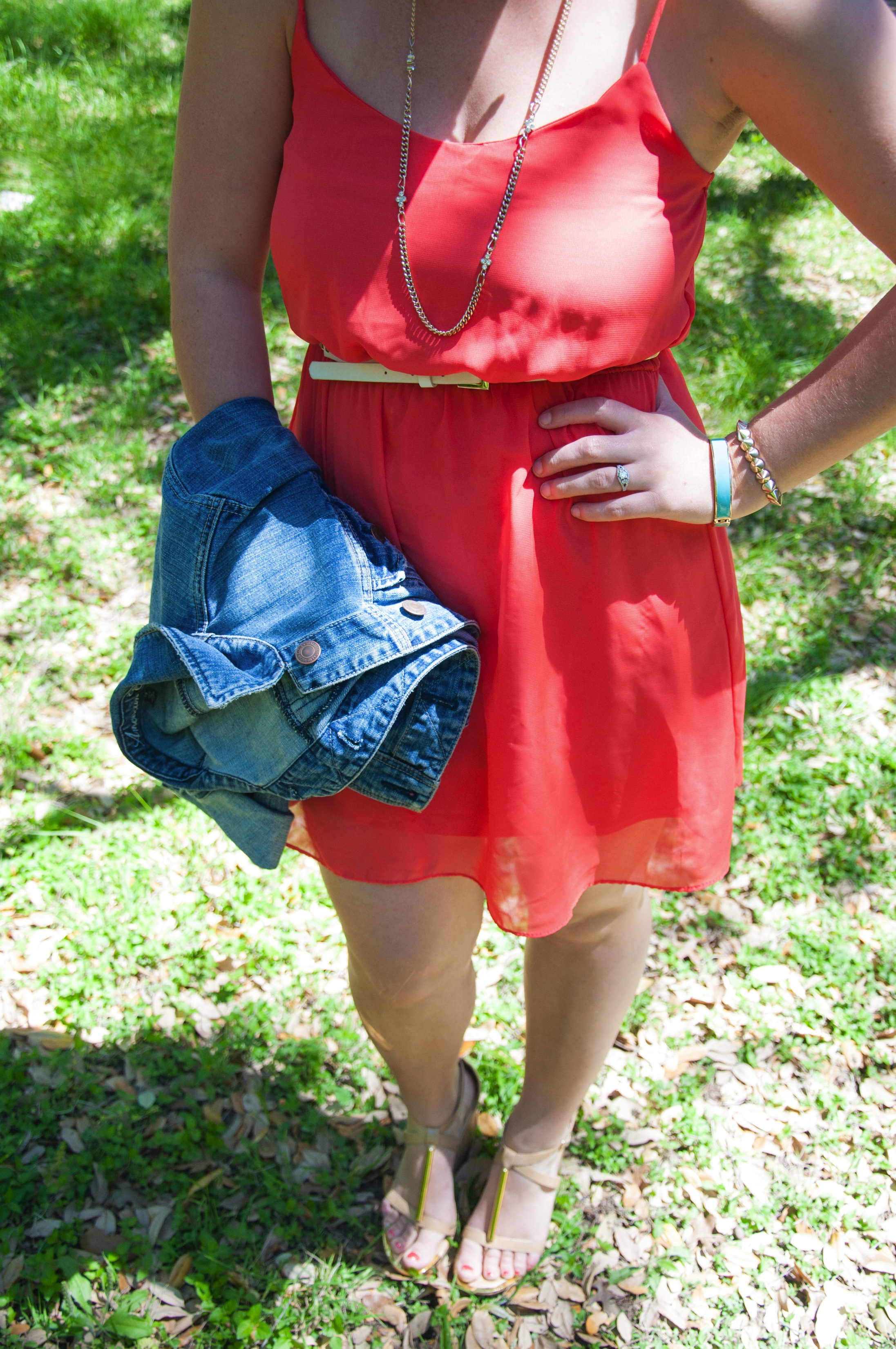 Denim jacket with coral dress