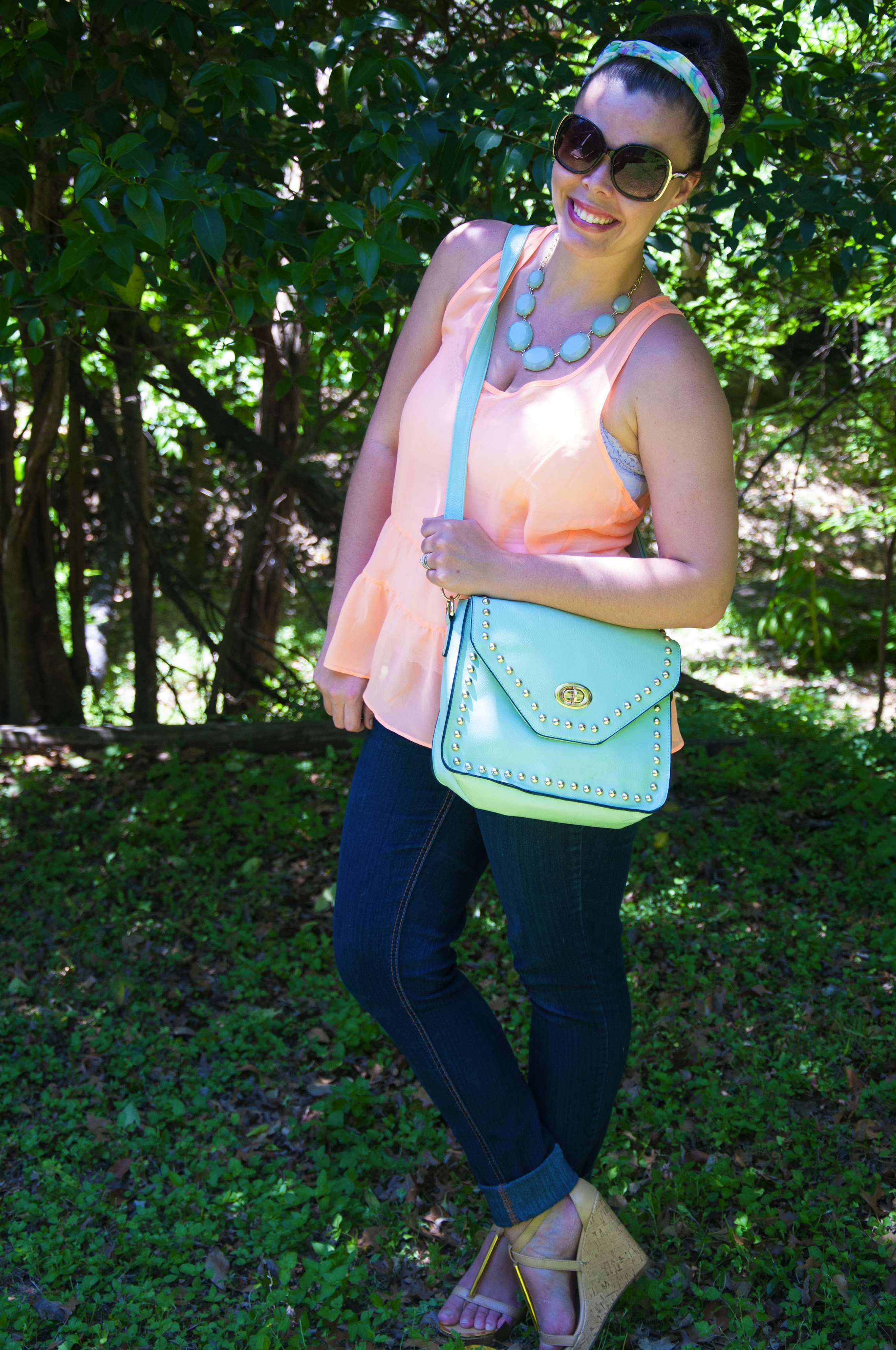 Peach ruffle top with mint accessories