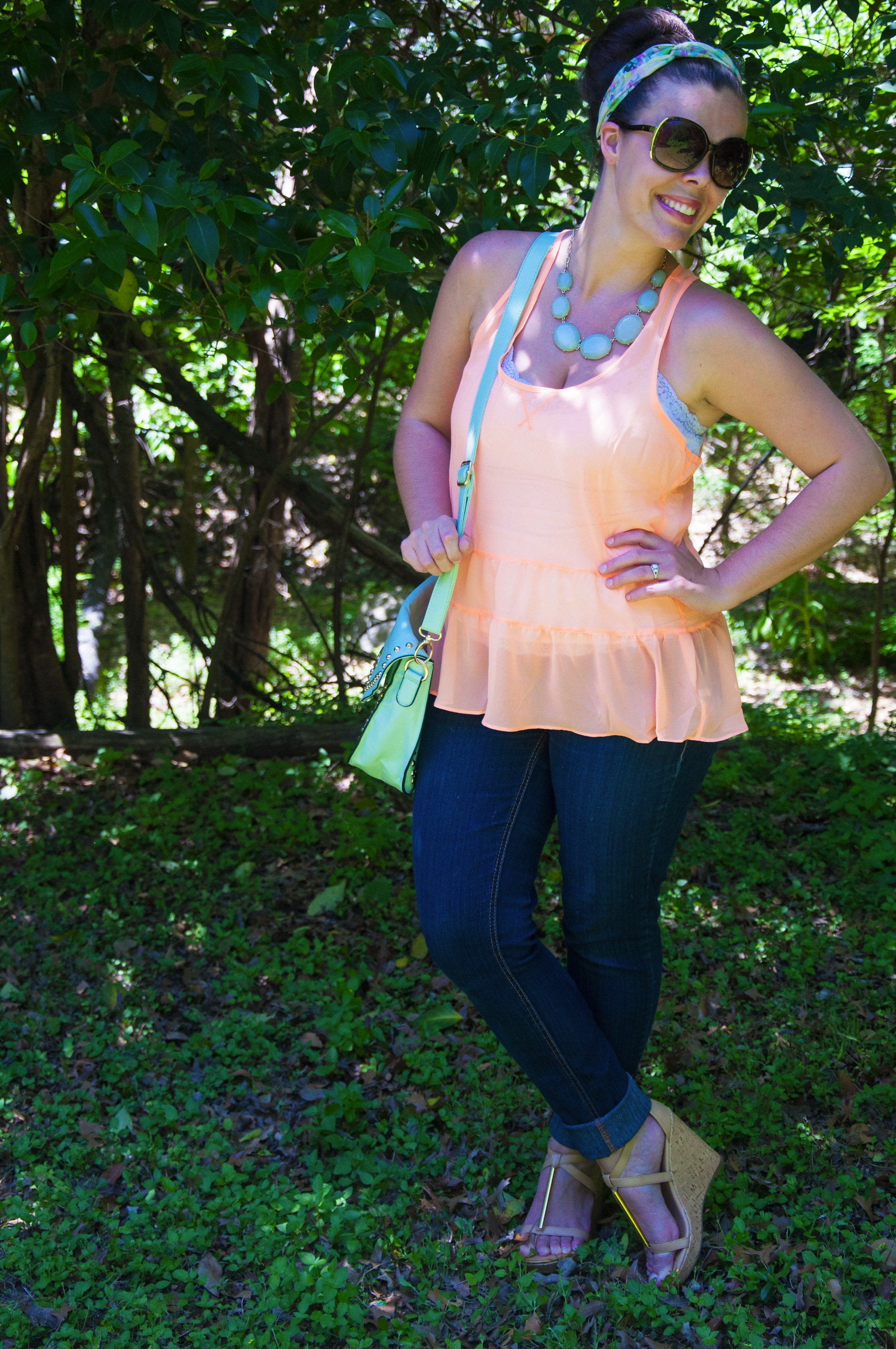 Peach ruffle shirt with mint necklace