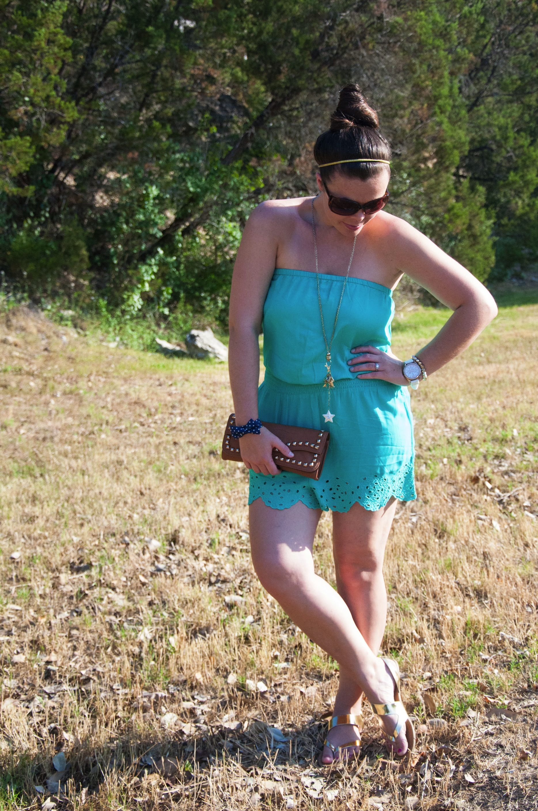 Turquoise romper with cognac clutch