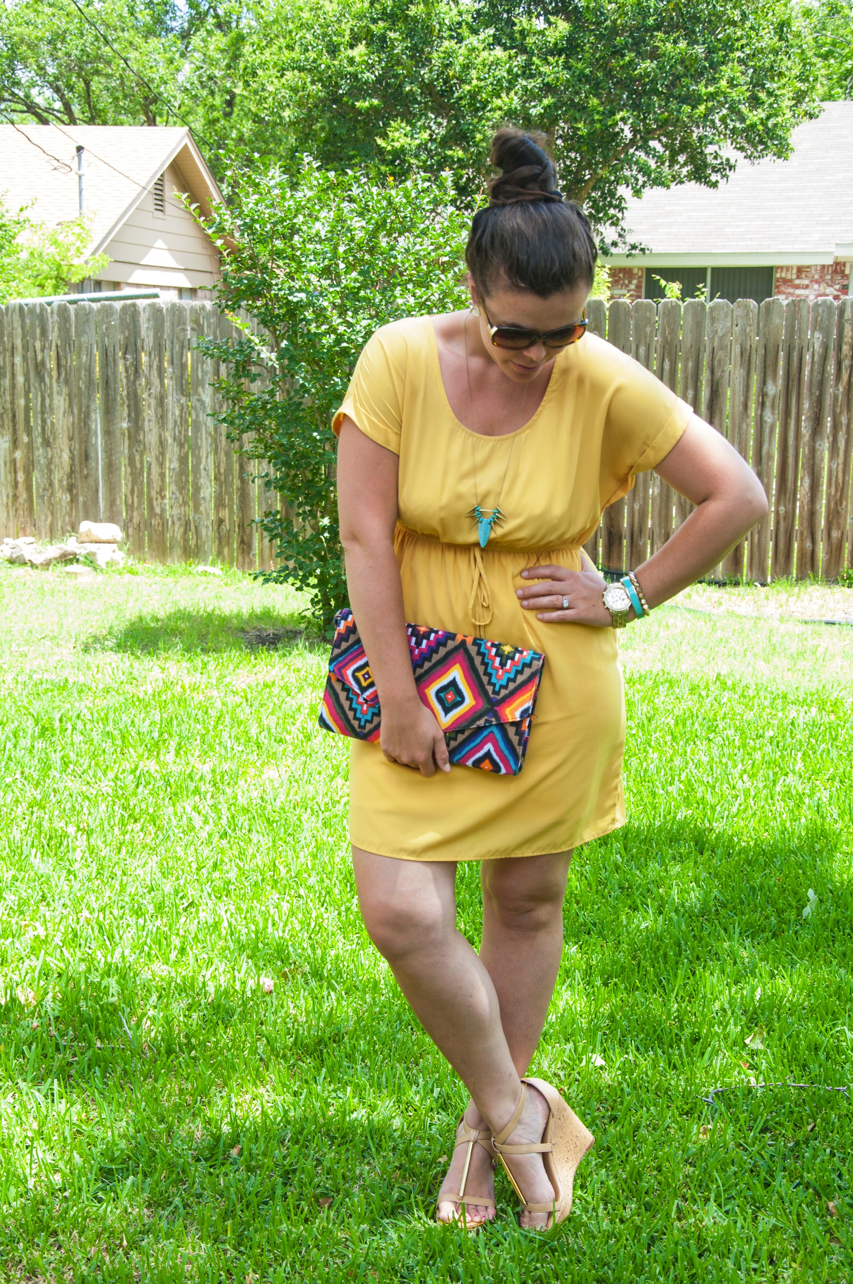 Yellow dress with aztec print clutch
