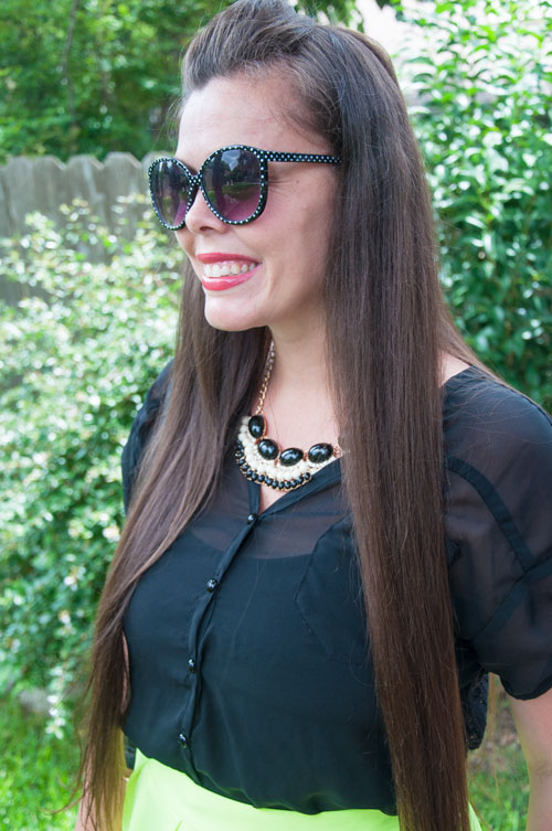 Black top with Kisspat Boutique necklace