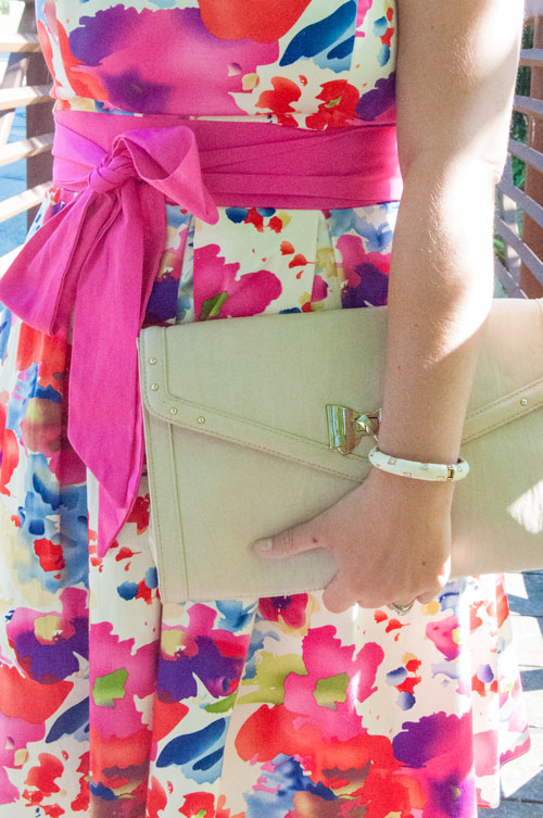 Pink bow dress with a nude clutch