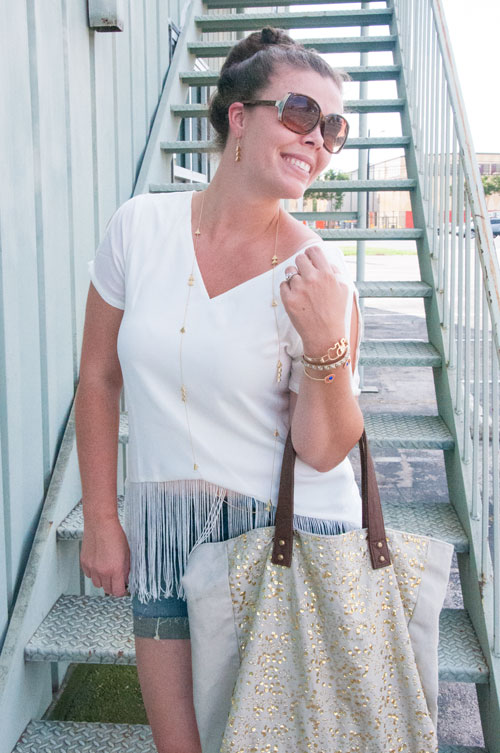 White top with gold sparkle bag