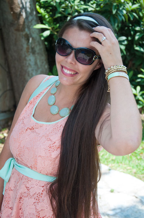 Mint and coral peplum top with statement necklace
