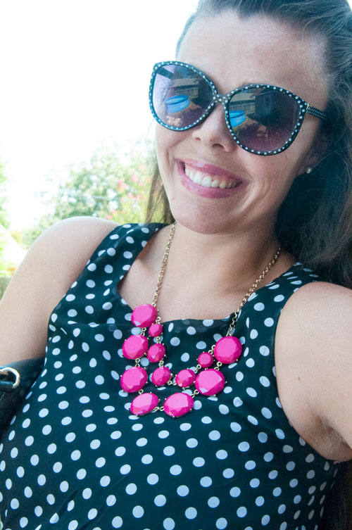 A pop of pink with black and white polka dots