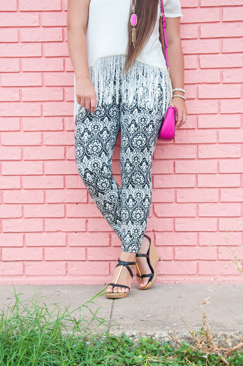Black and white patterened pants with pink accents