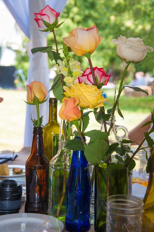 Wedding centerpieces- flowers in beer and wine bottles