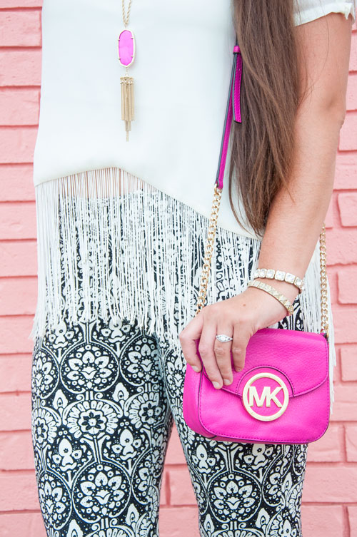 White fringe top with pink Kendra Scott Rayne necklace