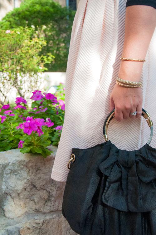 Black bow handbag with pink skirt