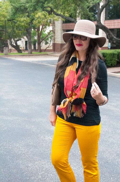 Mustard and black with a floppy hat