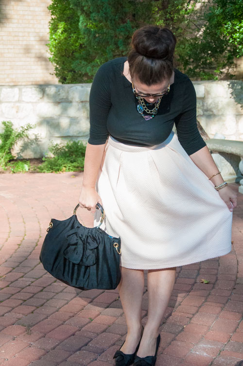 Pale pink midi and black accessories