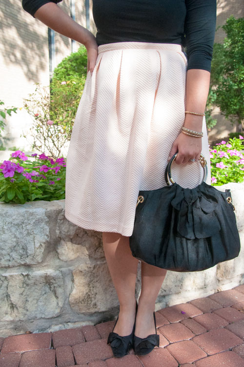 Pale pink midi skirt and black bows