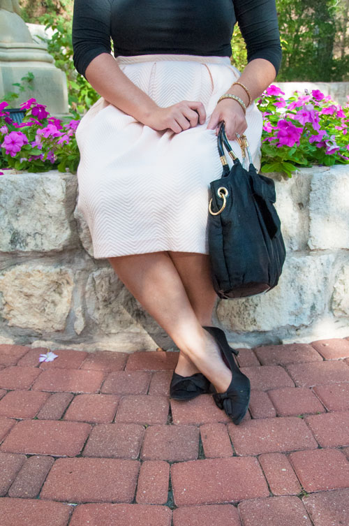 Pale pink midi skirt with black heels