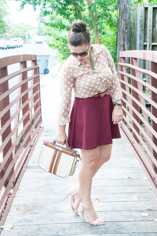Tan polka dot blouse and burgundy skirt