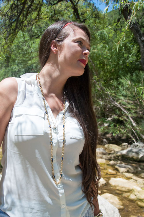 White top with gold chain necklace