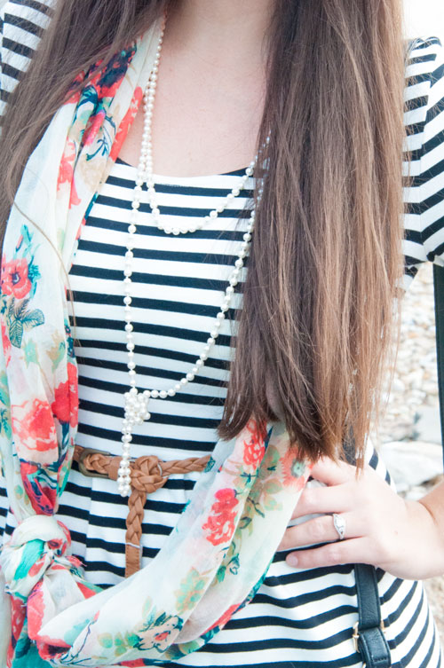 Floral scarf with pearls on a striped dress