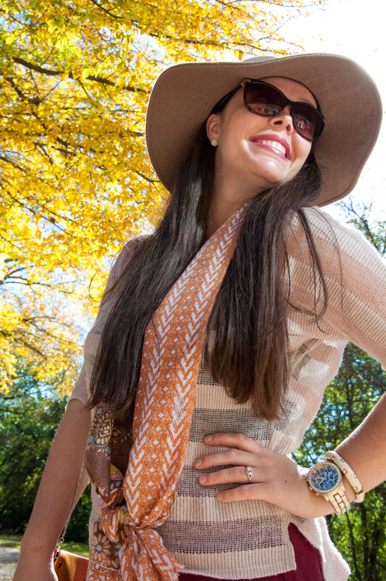 Fall hat and scarf with a tan sweater