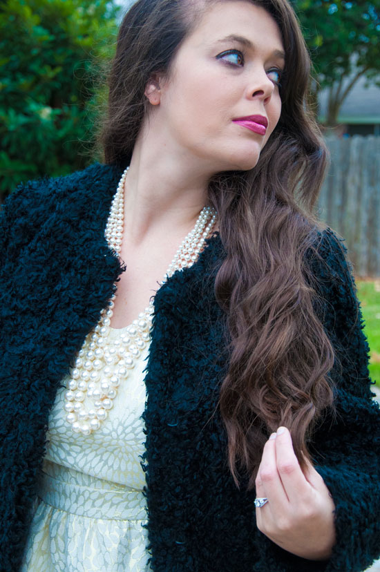Black fuzzy coat with a gold glittery dress