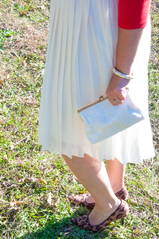 Cream chiffon pleated skirt with leopard pumps
