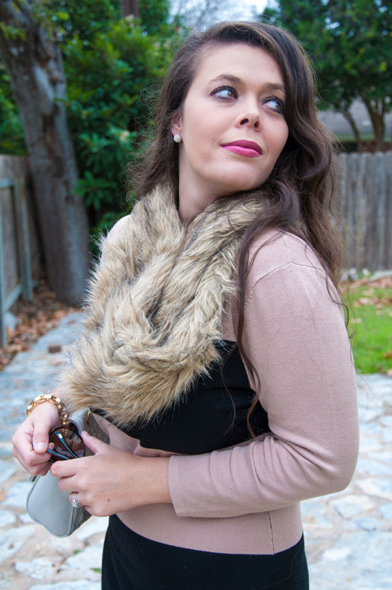 Fur scarf and tan sweater
