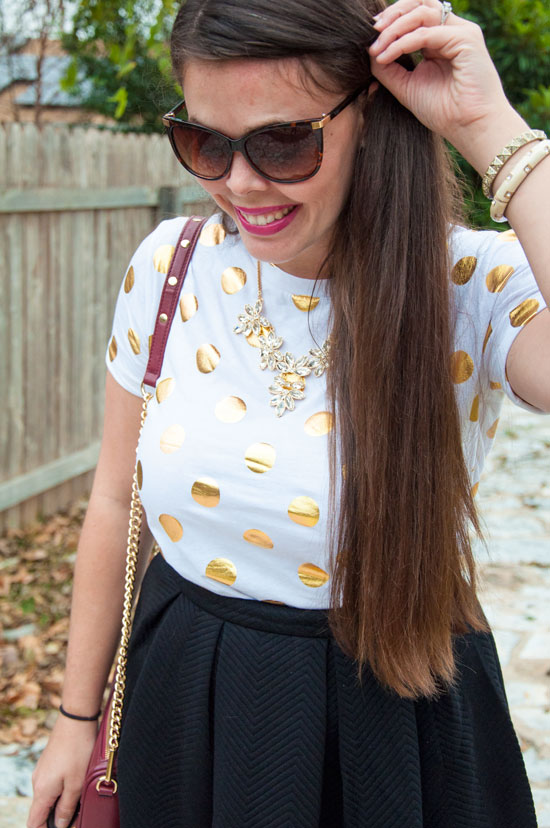 Gold dots shirt with a black midi skirt
