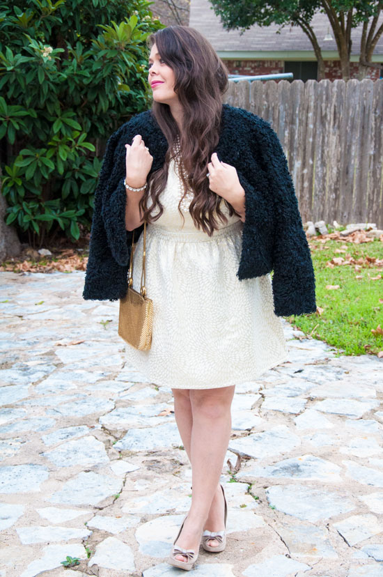 Gold shimmery dress with a black fur coat