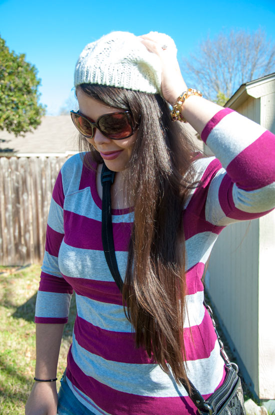 Maroon stripes and jeans with a cream hat