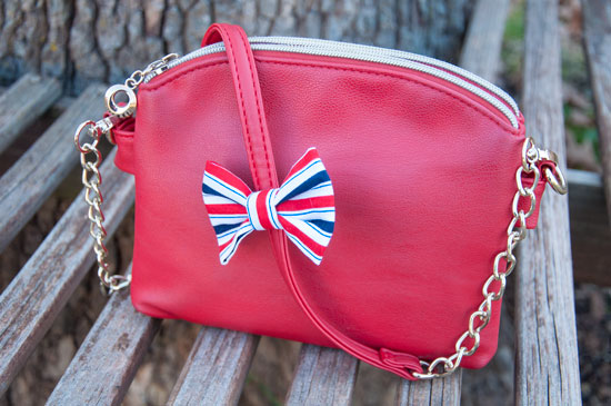 Red crossbody with a red white and blur hair bow